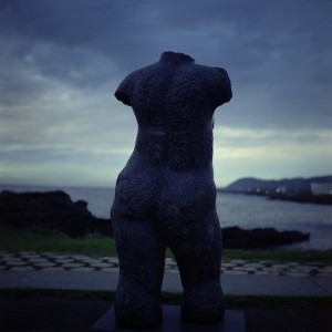 A-bronze-statue-with-no-head-that-faces-the-sea